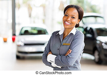 african vehicle saleswoman with arms crossed