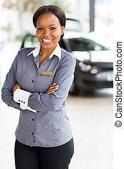 african woman working at car dealership - beautiful african...