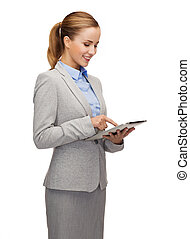 smiling woman looking at tablet pc computer