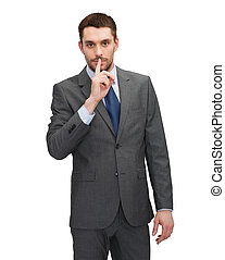 handsome businessman with finger on his lips - business,...