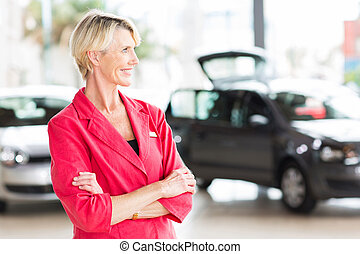 senior female car dealer principal - smiling senior female...