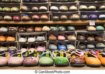 Shoes on display Variety of colorful shoes - Variety of...