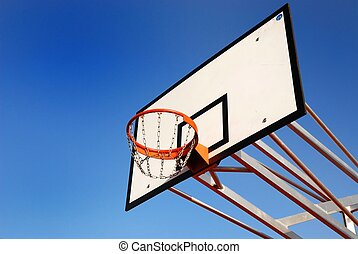 Basketball board against blue sky