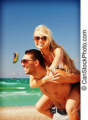 happy couple in sunglasses on the beach - picture of happy...