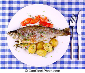 Grilled rainbow trout with red pepper, potato and lemon, top...