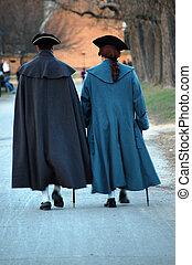 Two men walking in colonial dress - Photo depicts two men in...
