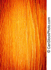 Closeup of wood. Orange wooden plank as background texture....