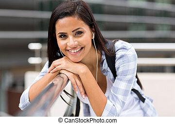 female university student on campus - smiling female...