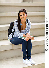 college girl sitting on stairs