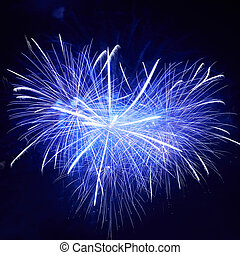 olorful fireworks - Heart shape of blue colorful fireworks...