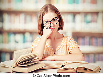 tired funny girl student with glasses reading books - tired...