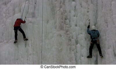 chipping - ice climbers chip at ice