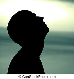 Man Silhouette - Toned photo of Man head Silhouette on the...