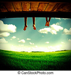 Legs hanging on Nature - Teenagers legs hanging down on the...