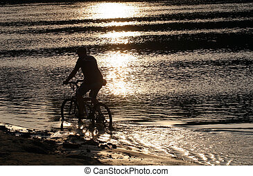Biker silhouette in the beach