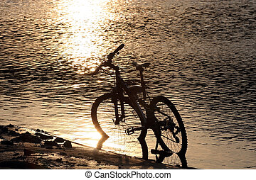 Bike silhouette in the river