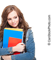 Shy student girl. - Portrait of a beautiful young brunette...