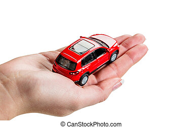 hand holding model of a car - a hand holding the model of a...