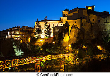 Night view of houses on rocks in Cuenca - Night view of...