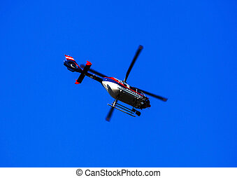 helicopter on blue sky, symbol photo for monitoring and...