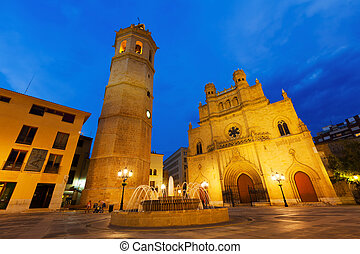 Wide angle shot of Fadri tower and Gothic Cathedral at Plaza Mayor in night. Castellon de la Plana, Spain