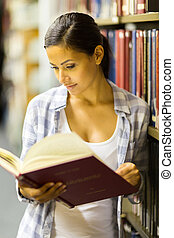 female university student in library - attractive female...