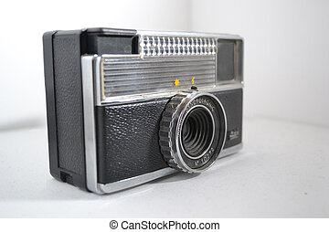 Old-Timer - Old film camera in a whitebox.