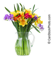 freesia and daffodil flowers in vase - multicolored freesia...