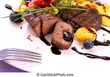 Lamb steak with potato, vegetable and balsamic sauce, close...