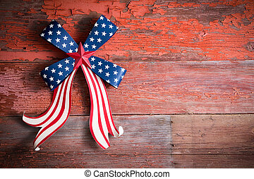Indepedence Day 4th July emblem with a blue stars bow and...