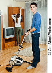 Man with wife doing housework - Adult man with wife doing...