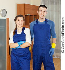 Handsome cleaners team cleaning floor