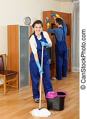 Cleaners team cleaning in room