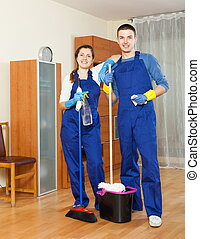 Two handsome cleaners cleaning floor