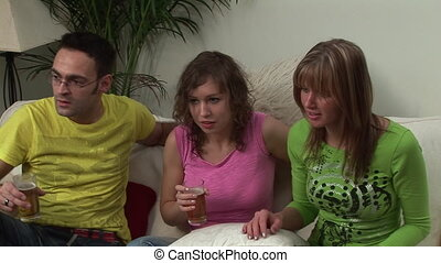 Group of Young Adults Watching Television - Young Adults...
