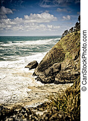 Rough Surf - Rough surf beating hard against the cliff at...