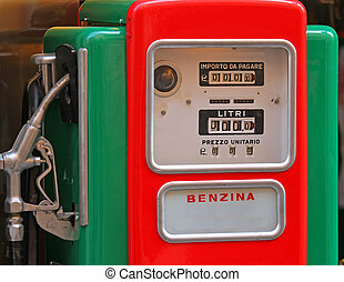 old gas pump to a gas station - vintage old gas pump to a...