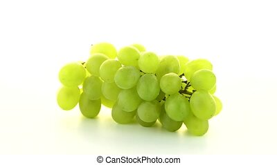 Green grapes rotating on white background