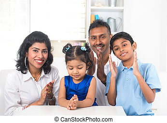 happy indian family indoor portrait
