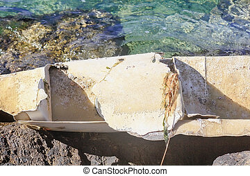 remains of a boat in the sea
