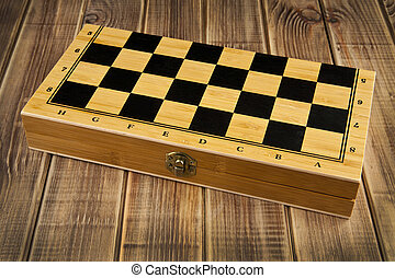 chess-board on a wooden background
