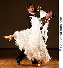 Professional ballroom dance couple preform an romantic...