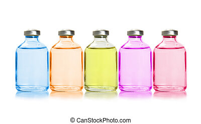 Five colored bottles with essential oils, isolated