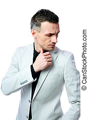 Pensive businessman looking away isolated on a white...