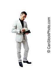 Businessman gets money from the wallet isolated on a white...