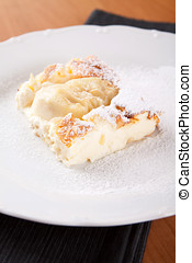 Cheesecake souffle with almonds sprinkled with sugar on...