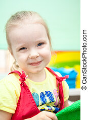 Portrait of young girl with smile on face