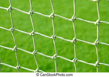 Soccer net on a grass background