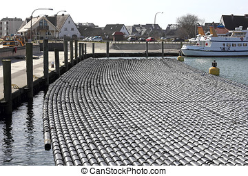 Pipes for mussel seed in harbour of Hoernum - In the Wadden...