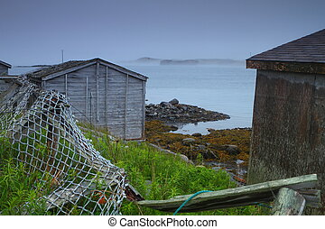 Old rustic huts - Old rustic fishing huts on the foggy shore...